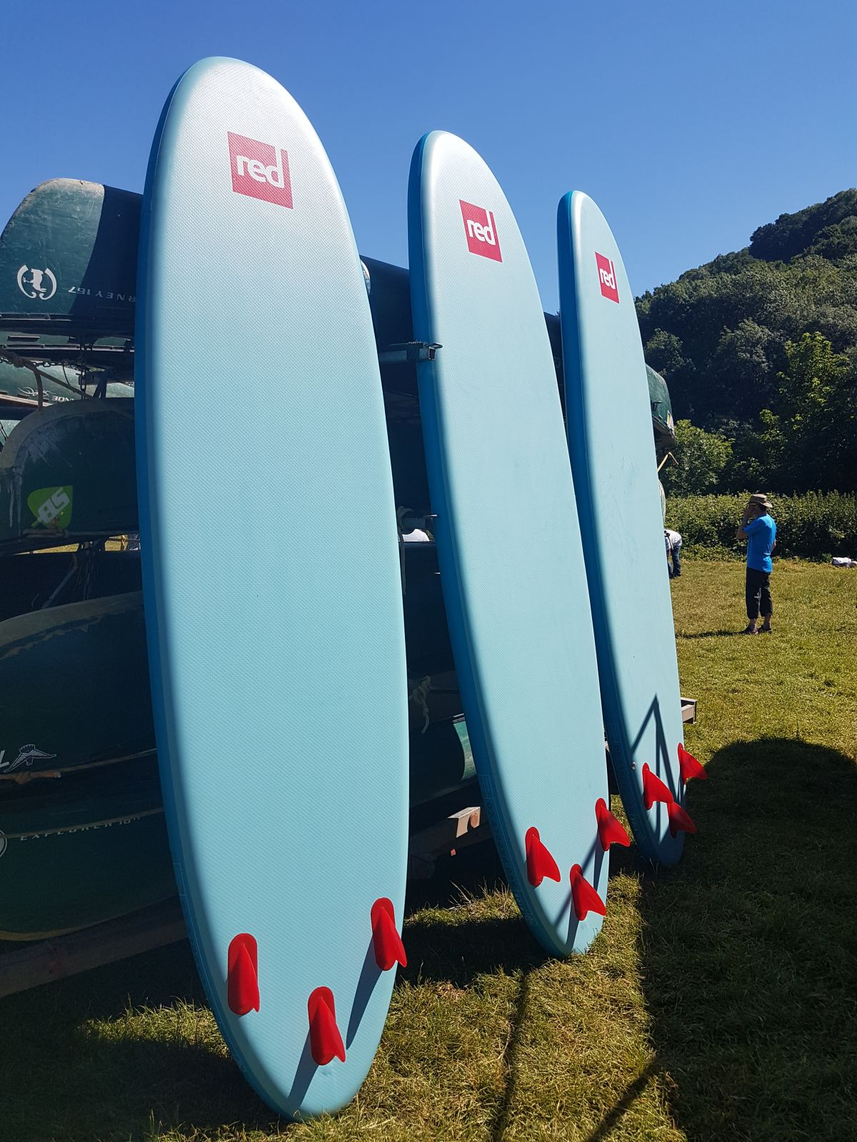 Red Paddle Boards in the sun ready to go