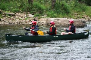 3 person canoe in the rapids