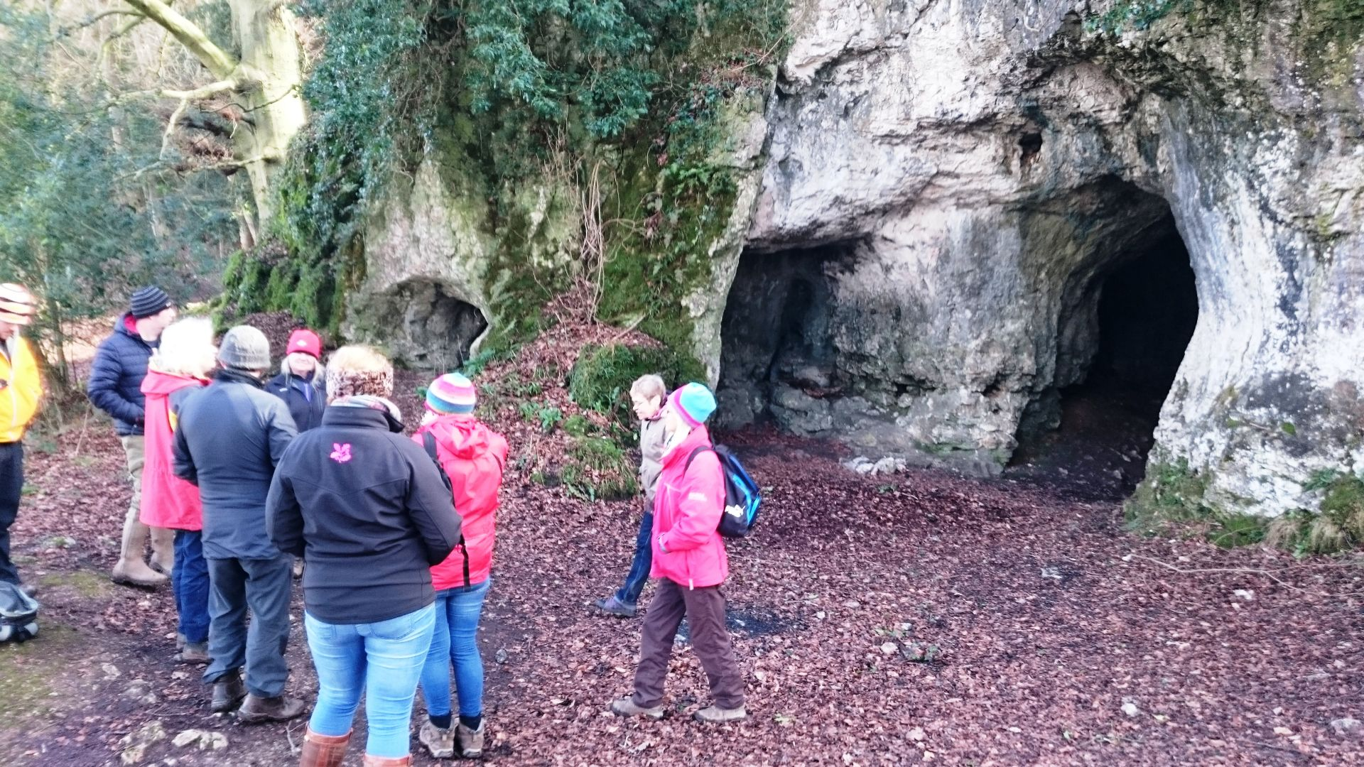 Exploring King Arthurs cave on a guided walk.