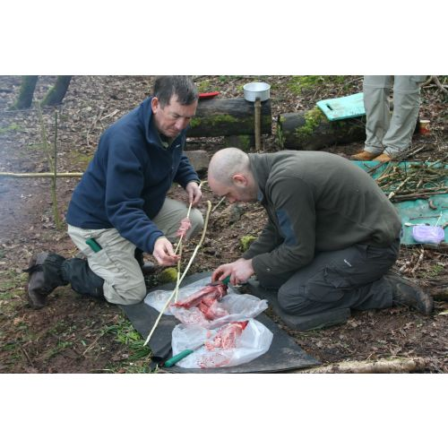 Preping the rabbits for the pot on a Bushcraft Session.